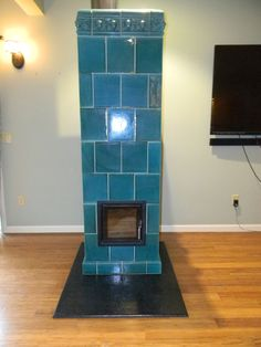modern pellet stove by gabaan burns sawdust pellets from. Black Bedroom Furniture Sets. Home Design Ideas