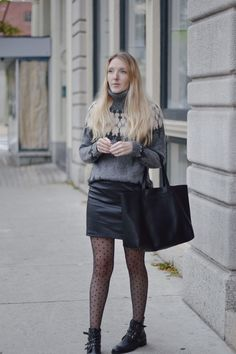 fashion blogger Leslie Musser pulling off statement tights in a cozy winter date night outfit on one brass fox