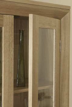 Safely store all your ornaments, books or dinnerware behind two tall glazed cupboard doors in this remarkably elegant unit. Oak Furniture Land, Furniture Wax, Oak Cupboard, Oak Sideboard, Light Oak, Drawer Handles, Solid Oak, Bathroom Medicine Cabinet, Dining Room