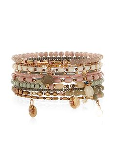 Embrace the global traveller trend with this set of ten stretch bracelets, embellished with a turquoise, terracotta, burgundy and ivory-coloured beads, plus gold-tone metal disc charms.