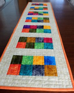 Quilted patchwork table runner, modern multicoloured table topper, dining decor, patchwork quilt, cream, orange, reversible patchwork runner - pinned by pin4etsy.com