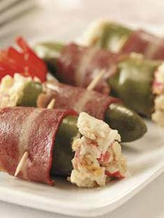 Bacon wrapped crab-stuffed jalapeno poppers.Oven baked crab-stuffed jalapenos.Delicious!!! Delicious!!!