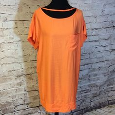 NEW YORK & COMPANY SHIRT STYLE DRESS Gorgeous orange shirt style dress. It has string belt loops but belt is missing. So your possibilities are endless as to... What belt shall I wear  New York & Company Dresses