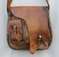 Leather Stitched Tooth Mountainman Blackpowder Shoulder Bag Purse I have to remember that bags are just as awesome with rough and ragged edges.I have to remember that bags are just as awesome with rough and ragged edges. Leather Art, Leather Pouch, Leather Tooling, Leather Purses, Leather Totes, Custom Leather, Distressed Leather, Vintage Leather, Leather Satchel