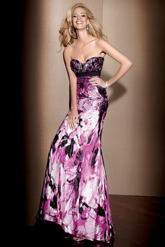 Just think of the fun you could have with your prom make-up in a printed silk evening gown such as the Claudine by Alyce dress 2073! This strapless floor length dress features a stunning multi colored floral print that drapes below a beaded strapless neckline!