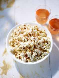 Ingredients:½ tsp sunflower oil, ½ garlic clove peeled & crushed, 20g (¾oz) uncooked popping corn, 10g (1/3oz) Parmesan cheese, pinch of salt. Preparation: Heat oil & garlic in a small saucepan. When oil is hot, add popping corn, cover with lid & cook over a high heat for 1 minute. When corn begins to pop, move pan back & forth over heat until popping subsides.  Remove pan from heat & carefully remove lid; some corn may still pop. Add Parmesan & salt, toss to coat, then serve.