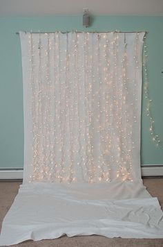 I know I have about 10,000 sets of Christmas lights...somewhere. And a white sheet is super cheap.