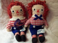 RAGGEDY ANDY ON LEFT DOES NOT HAVE SAILOR CAP.  RAGGEDY ANDY ON RIGHT HAS SAILOR CAP AND A SMALL HOLE ON PANTS LEG NEAR TAG IN SECOND PICTURE.  Second Picture Taken to show this.  BOTH ANDYS HAVE THEI
