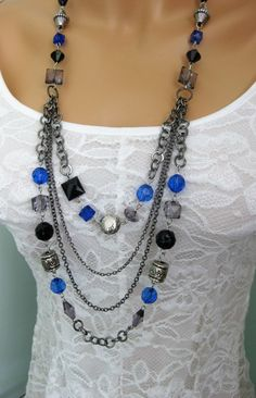 Multi strand long chunky beaded necklace with blue, black, silver, and smoke colored acrylic, and metal beads. The use of acrylic beads makes this necklace light weight. This necklace is made with chunky gunmetal chain, and is 34 inches long. Great with blue jeans.  This Black and Blue necklace is ready to send to you today. I carefully package it, and send it in a gift box making it easy and convenient for you to give as a gift if you wish.  ***SEE ALL THE BEADED NECKLACES IN MY SHOP AT…