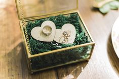 Wedding ring box and engraved wooden hearts to hold the rings