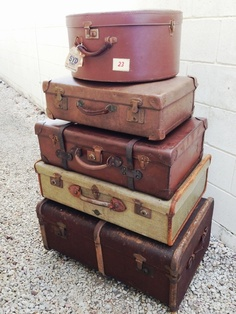Stack of 5 vintage suitcases