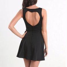 Black fit and flare dress size small Fit and flare dress in size small. Color is black. No damages. V neck in front. Zipper in the back of dress. Heart shaped cutout on the back of dress. Size small Dresses