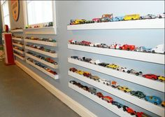 inspiration for Nico's room... miniature cars displayed on ledges, awesome!
