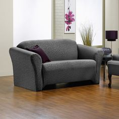 @Overstock - Fresca 1-piece Stretch Sofa Slipcover - The smooth surface and Victorian-inspired pattern of this Fresca sofa slipcover add an element of sophistication to your living room or den. Made of polyester and spandex, this machine-washable piece is easy to get on and off your sofa.  http://www.overstock.com/Home-Garden/Fresca-1-piece-Stretch-Sofa-Slipcover/9677860/product.html?CID=214117 $72.99