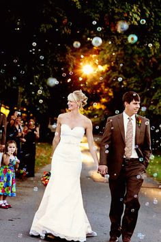 Totally having bubbles and bubble guns as we walk back down the aisle :)
