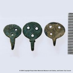 Hooked fasteners - These hooked fasteners of copper alloy are of characteristic type of late Saxon artefact. Each was pierced with three hol. Alfred The Great, Exeter, Fasteners, Copper, Type, Brass