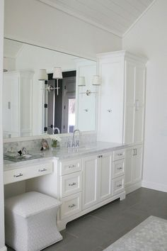 Traditional bathroom 446349013062743536 - Master bathroom with Carrera marble countertops, Circa lighting sconces, and custom white cabinetry. Master Bathroom Vanity, Small Bathroom, Marble Bathrooms, Bathroom Basin, Bathroom Renos, Bathroom Renovations, Bathroom Ideas, Bathroom Colors, Painting Bathroom Cabinets