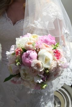 """plumptious style of wedding bouquet perfect for this time of the year, beautiful bossomy Peonies; """"Gardenia"""", """"Bowl of Cream"""" and """"Angel Cheeks"""" with English Garden Roses from David Austin """"Patience"""" & """"Keira"""" with """"Biedermeir"""" and """"Bombastic"""", luscious Sweet Peas, fragrant Lily of the Valley"""