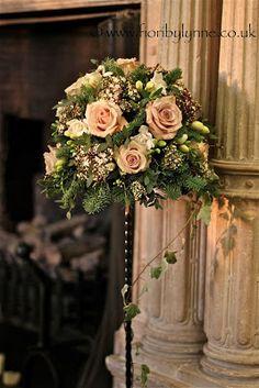 Sculptured floral arrangements for ceremony (2 arrangements either at alter or at entrance)