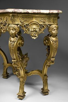 A rare and exceptional 18th century German Rococo hand carved giltwood console table with conforming wine colored marble top. The console was carved