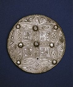 Silver disc brooch with Trewhiddle-style decoration against a nielloed ground.  Late Anglo-Saxon, late 9th c.  Beeston Tor Hoard, Staffordshire.  Diam 7.3 cm.  British Museum.
