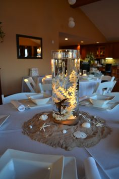 Centerpieces for beach themed baby shower, with real fish and floating candles