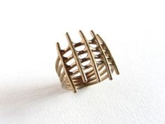 Men's cage ring. Cast bronze by Moragh Chisholm of FerosFerio Jewelry.