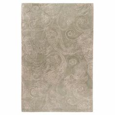 New Zealand wool rug with a paisley motif. Hand-tufted in India.  Product: RugConstruction Material: New Zealand wool and art silkColor: Oyster grayFeatures:  Hand-tuftedDesigned by Candice Olson Note: Please be aware that actual colors may vary from those shown on your screen. Accent rugs may also not show the entire pattern that the corresponding area rugs have.Cleaning and Care: Vacuum regularly with non-beater attachment. Blot stains immediately. Test cleaning products in discreet area…