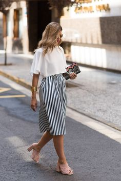 Perfect outfit. Midi skirt and loose shirt and those shoes, wow!