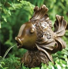 Supplement the pond water feature in the backyard with this lovely goldfish fountain spitter statue made of resin.
