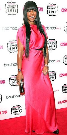 Kelly Rowland certainly had something to smile about at Cosmopolitan's Ultimate Women Awards in London on Nov. 3. The judge of the UK's X-Factor showed off her pearly whites as she rocked a floor-length pink frock, complete with a thin black belt and a few chic accessories.