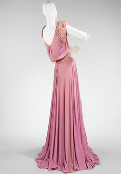 Evening Dress Charles James Spring/Summer 1946 Millicent Rogers was an important James client for whom he designed from the mid-1930s until her death in 1953. They collaborated on many of the designs for her dresses, Rogers suggesting fabric, color and sometimes cut. The collection holds a total of 65 of her garments by James and 78 supporting materials used in the creation of them. This dress was designed at Mrs. Rogers suggestion, made from a 25-yard of remnant jersey bought from Gimbel