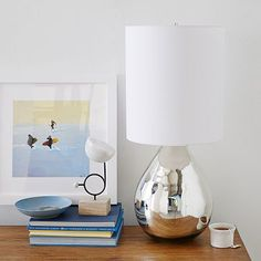 "WE. Glass Jug Table Lamp. (Mercury or Clear) 11.5""diam. x 31.75""h. $169"