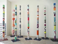 Sally Russell:Totems 2012 ceramic These multi-colored- totems are inspired by. - Sally Russell:Totems 2012 ceramic These multi-colored- totems are inspired by indigenous forms a - Garden Totems, Garden Art, Collaborative Art Projects, Group Projects, Group Art, Painted Sticks, Middle School Art, High School, Contemporary Sculpture