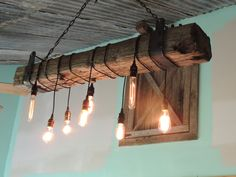 An Edison Light Inspired Railroad Tie Chandelier   -----DESCRIPTION-----   Light is handmade by shop owner from reclaimed railroad ties and flat stock steel. The chain is new to make sure it can handle the load of the light. Each light will be slightly unique since no templates are followed. The wood itself has to be cut to length with a chainsaw, so you can request either a plain cut end, or I can make it look weathered to match the factory end (if you dont specify which you want it will…
