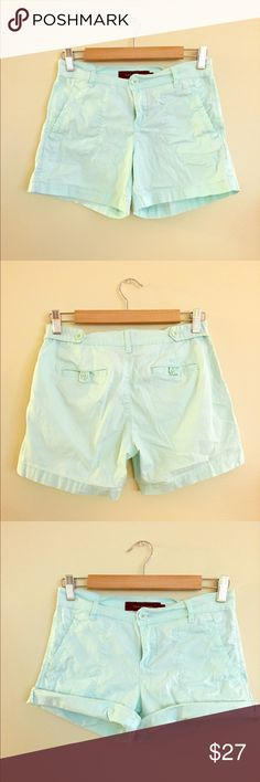 Calvin Klein mint colored shorts. Size 4 Calvin Klein shorts. Color is beautiful mint. Buttons details on back pockets and waist. Can be rolled up for shorter inseam. Great condition. Calvin Klein Jeans Shorts