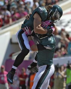 Best of NFL Week 6  --  Philadelphia Eagles quarterback Nick Foles (9) celebrates with wide receiver Riley Cooper (14) after Foles scored on a four-yard touchdown run against the Tampa Bay Buccaneers during the first quarter of an NFL football game Sunday, Oct. 13, 2013, in Tampa, Fla. (AP Photo/Phelan M. Ebenhack)
