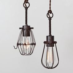 Oval Wire Bulb Cage Pendant Light Trouble Lamp Vintage Industrial Rustic Modern // Vintage Style Cloth Covered Twisted Cord & Bakelite Plug. $150.00, via Etsy.