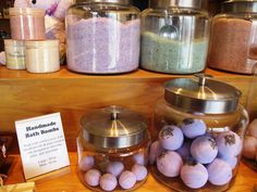 Display props with signage showing product details. Good idea for displaying soaps, bath salts or bath bombs at a craft fair.