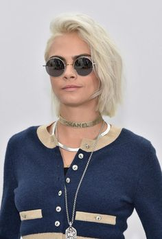 Cara Delevingne shows off hew platinum blonde hair at the Chanel show in Pais