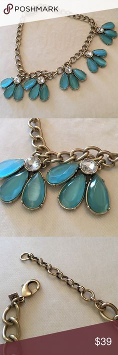 Banana Republic gold Tone and stone necklace Gold tone, more of an antique gold style necklace with teal petal stones and round clear stones. Adorable with a white shirt and jeans! One of my fave necklaces!!! Banana Republic Jewelry Necklaces