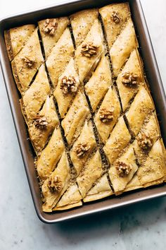 Holiday Walnut Baklava - buttery phyllo with layers of ground walnuts in between and drizzled with a homemade simple syrup with sweet orange blossom and rose water! So good! #baklava #walnutbaklava #lebanesebaklava | Littlespicejar.com