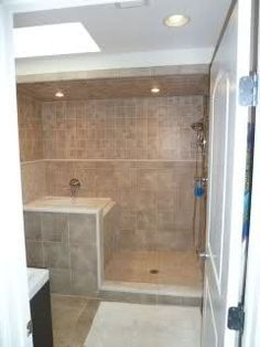 Small soaking tub. Genius  With a larger open shower area this would be Perfect!!!! Love it