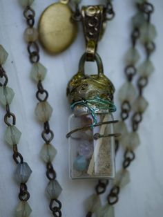 Necklace  Ghost in the Bottle  by urbangipsy on Etsy, $28.00 A bit of jewelry with magic in it