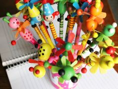 Pencils with the cutest springed clown/animal toppers  http://foodbetterbegood.blogspot.com/2013/11/channapatna-town-of-toys.html