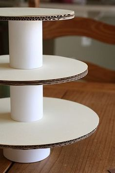 Make a cupcake stand/tower out of cardboard rounds, wrapping paper & ribbon. The possibilities are endless and a cheap alternative to a regular cake stand.