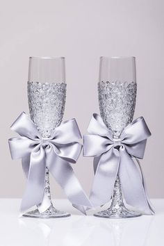Wedding glasses SILVER Personalized glasses silver Champagne flutes silver Toasting glasses laser engraved Flutes set of 2 For these glasses color: silver or rose gold All completely handmade! MEASUREMENTS: -Champagne flutes : Height - 9.2 inch (23.5 cm). Volume – 170ml (6.1 oz) Custom champagne glasses may be created to fit your needs. Your unique wedding colors can be used for this design. Names and date may be painted to customize to your occasion. Glasses will be carefully packed for…