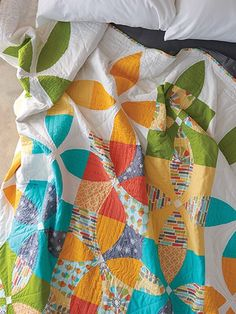 Organic shapes and movement are possible with this Picnic Petals Quilt. Award-winning design and easy to follow templates included with pattern download.