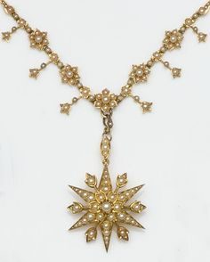 Late Victorian half pearl set necklace composed of flowerhead clusters with flowerbud drops between