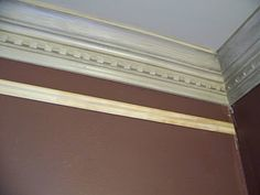Add two elements to your crown moulding to make it appear taller and more substantial